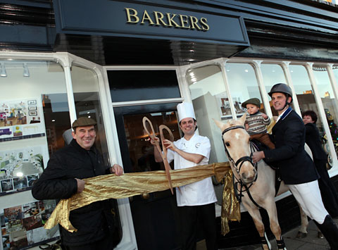 Charles Barker, left, head chef Pablo Bouza-Causier, young Charlie Barker on Tasmania the pony and Paul Barker at the opening o