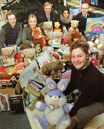 Katherine Sharp, Monks Cross Shopping Centre manager with toys and goods donated in December. Looking on are Paul Draper; Samanatha Beckett; Mike Laycock and Rehema Figueiredo and Major Andrew Dunkinson