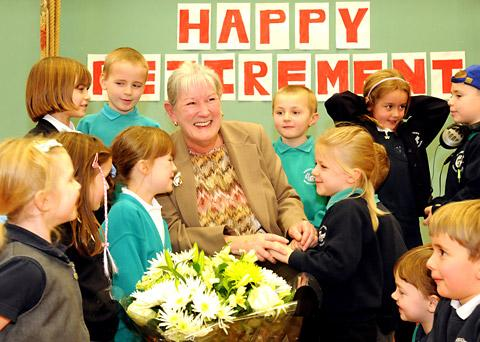 Becky White surrounded by pupils at her retirement party after 16 years as headteacher of Bishopthorpe Infants School