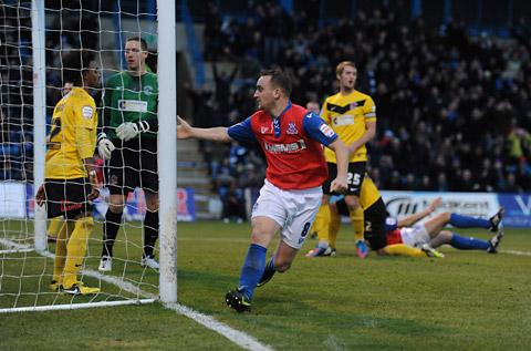 Gillingham's Charlie Lee celebrates scoring his side's first goal against Fleetwood Town