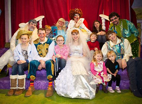 Members of the cast of Jack And The Beanstalk with foster carers' children