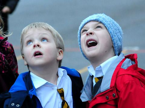 Youngsters at St Wilfrid's RC Primary School, in York, watch as Santa hovers above them in a Sea King helicopter