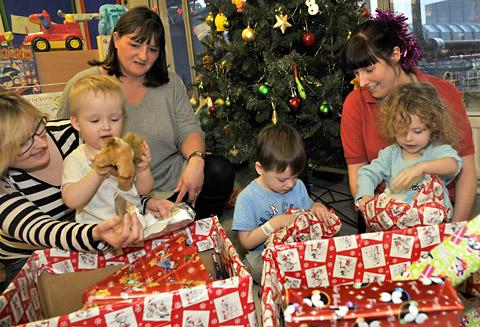 Opening presents on the children's ward at York Hospital are, from the left,  Jude Burden with her son Harry, Sarah Talbot from Aviva Restaurant Associates, Anthony Giles, and play specialist Rachel Wilson with Phillipa Humble