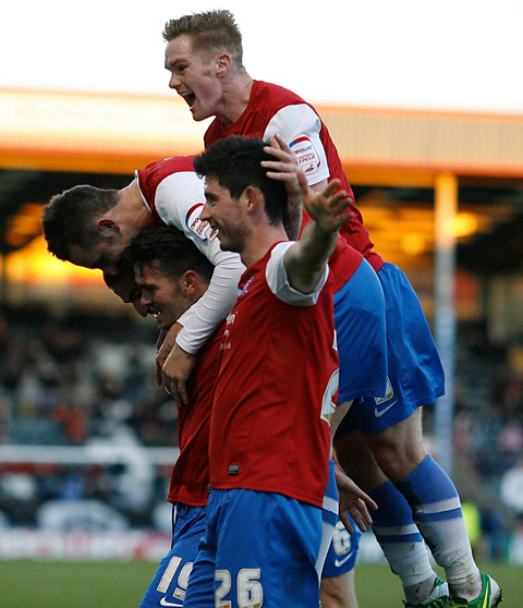 Jason Walker tops a celebratory pile of Minstermen in the win at Rochdale