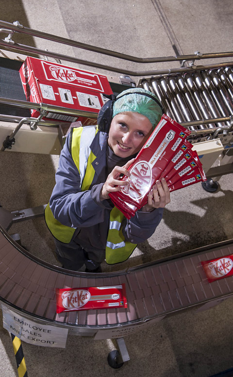 Nestlé worker Anna Grzegorczyk packs the first batch of the new Fairtrade two-finger KitKat off the production line at the     factory in York