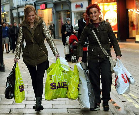 Shoppers carry away their bargains