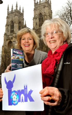 Elaine Newington Ward, right, recieves her prize for designing a logo for a Mensa gathering in York in 2013 from Gillian Crudas, chief executive of Visit York