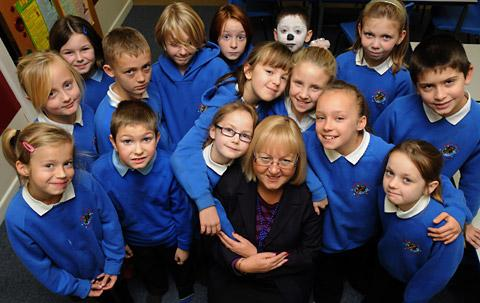 Derwent Primary School headteacher Carole Tarode pictured with Class 4 pupils before retiring at the end of term