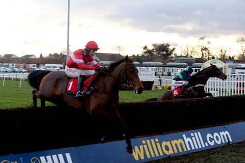 Sanctuaire, left, ridden by Ruby Walsh, wins the williamhill.com Desert Orchid Chase, the feature race on day two of the William Hill Winter Festival at Kempton