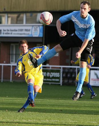 Pickering Town's John Heads, pictured left firing in a free-kick, got on the scoresheet at Glasshoughton on Boxing Day before suffering a dead leg but he should be fit to face Winterton Rangers tomorrow