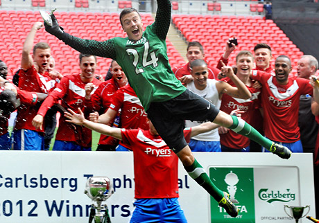 York Press: Nigel Holland: City goalkeeper Michael Ingham leading the celebrations after the FA Trophy victory at Wembley, May 13