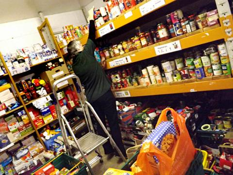 Dr Cameron said using cards instead of food donations would free up volunteers' time (library picture)