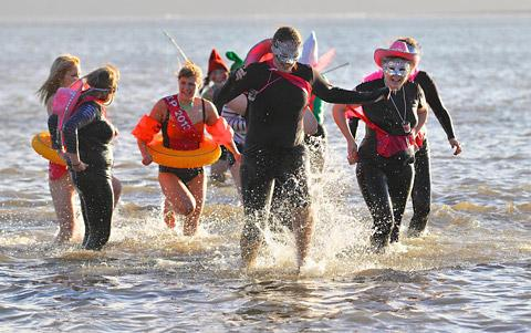 Swimmers plunge into the chilly North Sea at Scarborough's South Bay to raise money for charities
