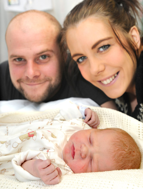 Little Grace Loughton, who was born at York Hospital on New Year's Day, the same date as her mum, Sarah. Also pictured is dad, Dave