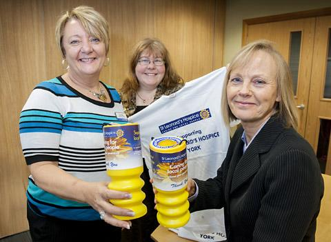 Pictured are Barbara Stephens of Hethertons with Annie Keogh and Sue Miller, from the  team at St Leonard's Hospice