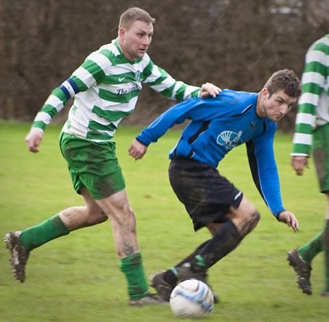 Acomb Celtic's Lee Powell is pictured, left, tracking Skelton's Neale Holmes in his side's 10-0 triumph in division one of the Ian's Cars of Barlby York Sunday Morning Football League