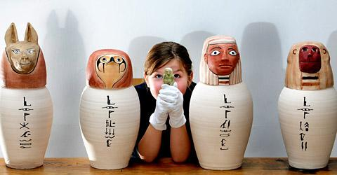 Jess Ferguson, nine, among Canopic jars at the at the Yorkshire Museum,