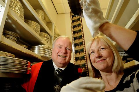 Sue Howard, director of the Yorkshire Film Archive, with Lt Col John May, the Master of the Company of Cordwainers, who visited the University of St John-based organisation to view historic films before the showing at Bedern Hall