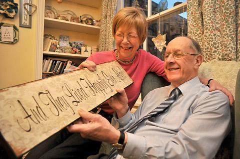 Peggy and Michael Lister, of Clifton, York, who were recently married at St Martin's Church holding a board saying And They Lived Happily Ever After, which was given to them by a friend