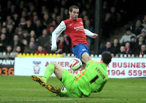 York City forward Matty Blair is denied by diving Exeter City 'keeper Artur Krysiak, a former Minstermen loan signing, during Saturday's 2-1 npower League Two defeat