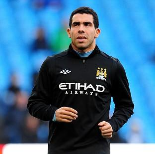 Carlos Tevez, pictured, feels motivated after Roberto Mancini's praise of Robin van Persie