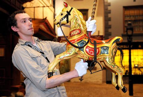 Robert Wake with one of the carousel horses in York Castle Museum's Kirkgate area