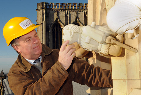 Andrew Arrol, the surveyor of the fabric at York Minster, examines stonework high up on the east end of the landmark after concerns were raised about olive oil being used as waterproof coating