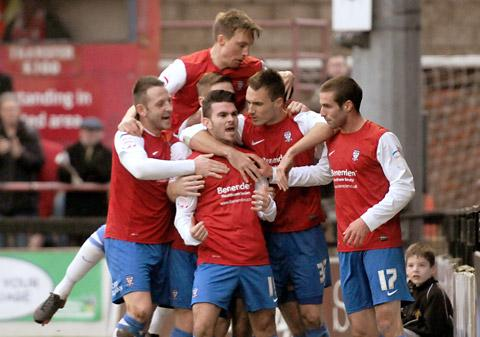 York City goalscorer Michael Potts is mobbed by his team-mates during the 2-1 defeat against Exeter.