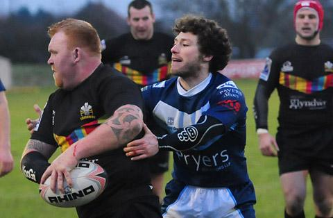 York City Knights  half-back Jonny Presley, above right, tackles  ex-York  forward Ryan McDonald