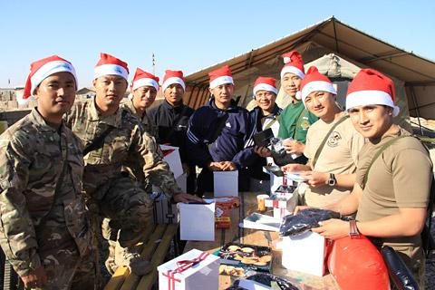 Members of 2 Signal Regiment in Afghanistan with some of the cards and gifts they received