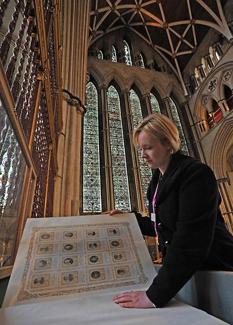 Minster collections manager Vicky Harrrison leafs through the King's Book of York Heroes, which is held in the North Transept