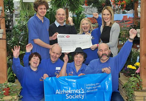 Dean's staff with their £19,787 donation to the Alzheimer's Society; Ruth Wilson, Chris Bedford, Hazel Abbey, and Mike Standlick, with back, from left, Anthony Freeman, Anthony Georgiou, Freda Metcalfe, with Beckie Smith of the Alzheimer's Society