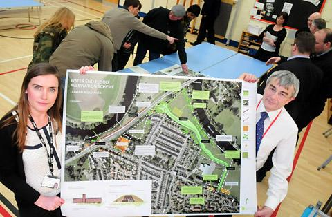 Helen Tattersdale, of the Environment Agency, and Mike Tavener, flood risk manager with City York Council, at the meeting at St Barnabas' School to give residents a preview of the latest flood defence work
