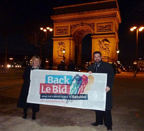 In Paris, Cllr James Alexander and Kersten England celebrate the news that Le Grand Départ will leave from York.