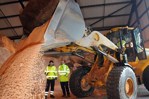 Coun David Levene, left, the City of York Council cabinet member for environmental services, and Martin Horner, the council's head of engineering, watch as salt is prepared to fill salt bins across the city