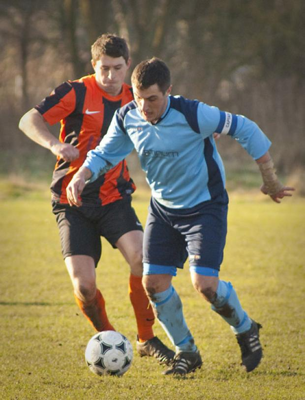 Severus player Steve Rambridge gets away from a Station rival. Picture: Ian Parker