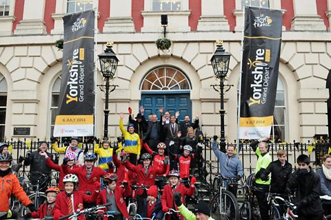 Cyclists gather outside the Mansion House in York as Tour de France director Christian Prudhomme joins the Lord Mayor, Coun Keith Hyman, and others on the steps