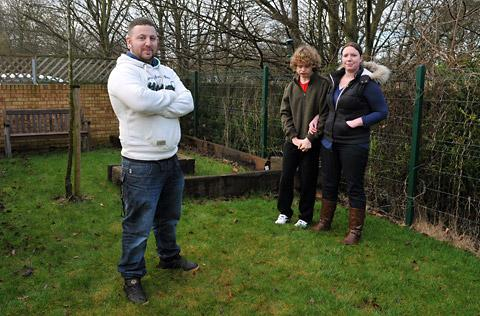 Dean Theaker, who wants to help build a sensory garden at Huntington, watched by Joseph and support worker Kim Lancaster