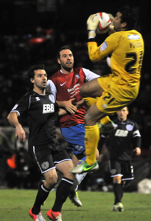 New signing Ben Everson, centre, in the thick of the action on his debut for York City against Aldershot