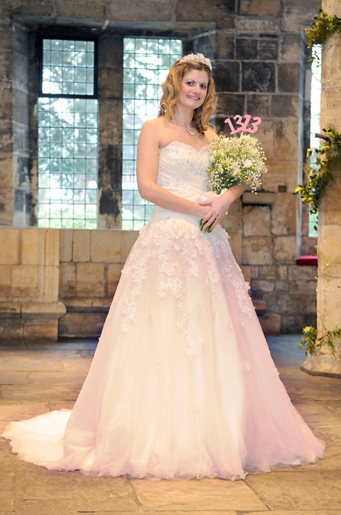 Melody Beavers, wedding and events co-ordinator, models a wedding dress at the Hospitium, which is discounting rates for