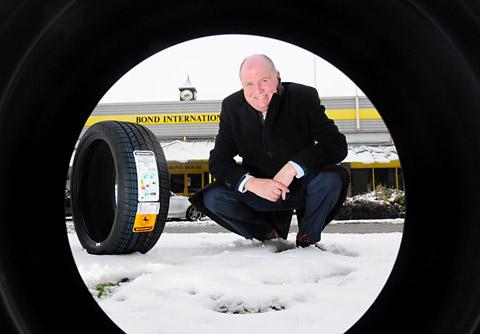 Steve Tidmarsh, director of Bond International,  with a winter tyre