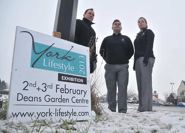 Richard Keast, of Astek Garden Design with Paul Smith and Laura Thompson, of Quartz Travel, with a York Lifestyle board in Malton Road