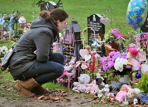 Kia Stone at the graveside of her daughter, Telan