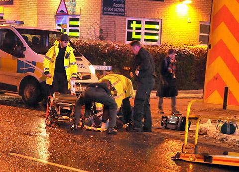 Emergency crews tend to the victim of the assault in York Road, Acomb