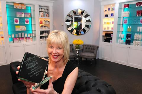 Clinic director Sharon Moore inside the newly refurbished interior of Face etc... medi spa with her award for Best Clinic 2012-13