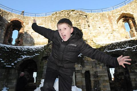 CLIFFORD'S TOWER: George Gregory, ten, from Huntington, enjoys his visit to one of York's most historic buildings