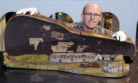 John McGoldrick, the National Railway Museum's curator of collections, with a section of the Invernecky and Drambuie model railway, which fits into a banjo case, and will be part of the railway toys exhibition at the National Railway Museum