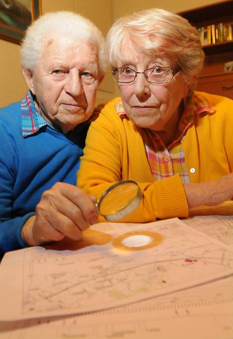 David and Rosemary Nattriss examine the route of the proposed line which will put their home at risk.