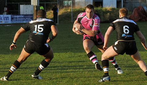 York City Knights front-rower Russ Dale on the attack against Hull duo Zak Braham, left, and Andrew Ward