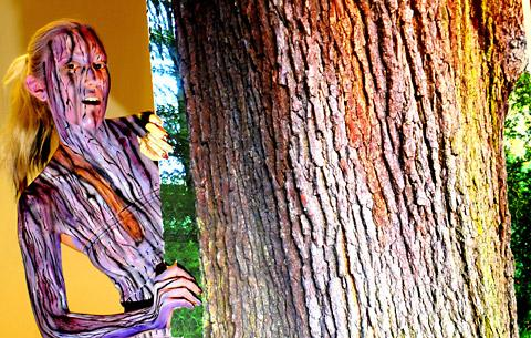 """Tree dweller"" Hannah Meakin models the work of Charlotte Francis-Sutton in the face- and body-painting section of the York College hair and beauty competition."
